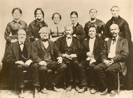 The N.I. Daniells Family.  Front row from left to right: John Graham, Nathaniel Irish Daniells, Elias Daniells, David Daniells, Nelson Daniells.  Back row: Matilda Daniells Graham, Lucinda Reed Daniells, Almeda Daniells Davis, Sarah Harris Daniells, Laura Philips Daniells, and Olive Boorn Daniells.