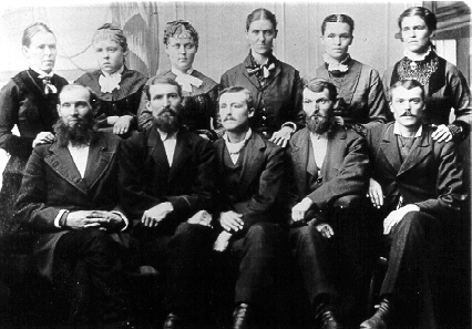 The 11 Plowman brothers and sisters.  Dora is 2nd from left, back row.
