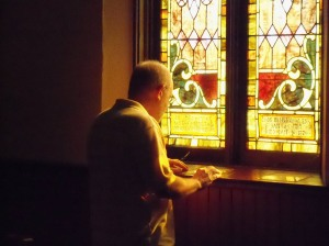 Jim reads inscription on the Agnes Stephenson window.
