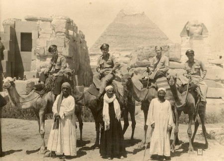 Bill Winegar and buddies mount up on camels.  Bill is 3rd from left.