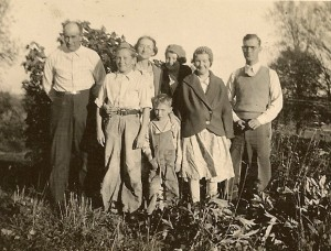 One of the few pictures of the entire Edd Winegar family.  Back row left to right, Edd, Bill, Myrtie, Irene, Esther, and Donald.  Paul, front center.