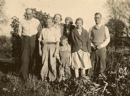 One of the few pictures of the entire Edd Winegar family: left to right, Edd, Bill, Myrtie, Paul, Nina, Esther, and Donald.