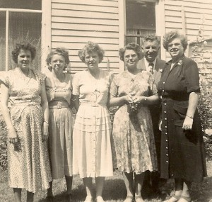 The five Daniells sisters at Dora's wedding.  From left to right, Jean Lowell, Eleanor Daniells, Betty Daniells, Mary Winegar, John and Dora Panchik.