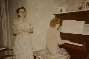 Mary sings while Eleanor plays the piano, 1952.